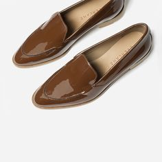 "Same elegant Modern Loafer now with a high-gloss finish. The leather is chrome-tanned then treated with a high-gloss lacquer. Like all patent leather shoes, these will not stretch over time. The shoe features stitching details over the toe and a 3/4"" stacked leather heel."