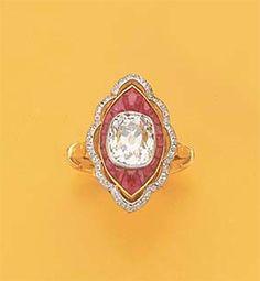 AN ART DECO RUBY, DIAMOND, GOLD AND PLATINUM RING, circa 1925
