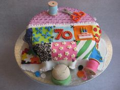 70th Birthday Cake - sewing basket with patchwork quilt - This cake was for a 70th birthday. The lady is very keen on patchwork quilting.  All the bits and pieces are made of gum paste or fondant and the basketweave is piped in royal icing.