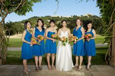 Orange, pink and green wedding bouquets stands up to bright sunlight at this country club wedding in the South Bay. Photo courtesy of Magnolia Photography. Bridal party bouquets by Seasonal Celebrations.