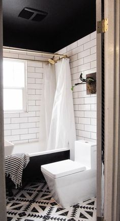 Love the bold floor, black and white color scheme with brass accents.  Capree Kimball's Bathroom Makeover