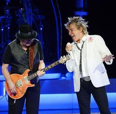 Carlos Santana and Rod Stewart perform together ahead of their US co-headlining tour launching May 23. These two superstars are seen here during Rod Stewart's show at Caesars Palace on May 6, 2014 in Las Vegas (Photo credit: Denise Truscello / WireImage / www.DeniseTruscello.net).
