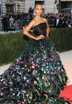 Intricate: The 37-year-old star's elongated skirt featured several multi-coloured feathers...