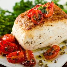 Roast halibut with thyme-roasted baby tomatoes