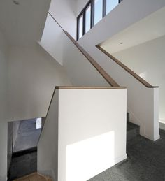 0130 Liverpool SIPS House - The stair spirals its way up the rendered bedroom block to reach the upper floors. Garden views can be had at each stage of the journey.