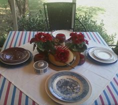 Mixing and Matching place settings is fun!  Gotta love vintage sheets for tablecloths too!  Our Back Porch