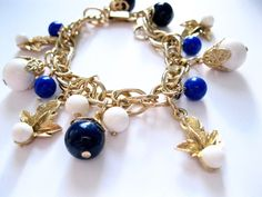 ON SALE Vintage Gold Charm Bracelet Blue White Beads Kitschy 1950's Costume Jewelry by ToucheVintage on Etsy https://www.etsy.com/listing/287455587/on-sale-vintage-gold-charm-bracelet-blue