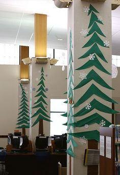 Decorate the office with paper trees on pillars and walls