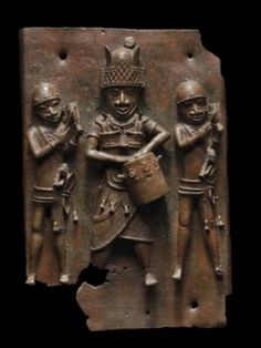 Relief plaque showing a dignitary with drum and two attendants striking gongs | Copper alloy | Possibly 16th century | Nigeria | Museum of Fine Arts Boston.