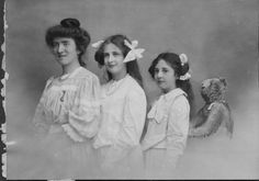 Brooklyn-born sculptor Frederick MacMonnies' daughters Betty and Marjorie, flanked by their governes
