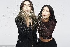 Pucker up! Kendall, 20, and Kylie, 18, can be seen blowing gold glitter in this stunning shot of the duo