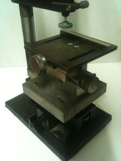 Precision Grinding Table by hedley -- Homemade precision grinding table intended for use in conjunction with a Dremel-based press to shape HSS bits. http://www.homemadetools.net/homemade-precision-grinding-table