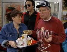 "Phil Hartman appears as Bill Clinton on an episode of SNL. In one of Hartman's most famous episodes, Clinton visits a McDonald's. When he met Clinton in 1993, Hartman remarked, ""I guess I owe you a few apologies."" Clinton showed good humor & sent Hartman a signed photo with the text: ""You're not the president, but you play one on TV. And you're OK, mostly."" For his Clinton impression, Hartman copied the president's ""post-nasal drip"" & the ""slight scratchiness"" in his voice."