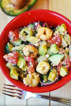 This jazzed up Greek salad is full of avocado, tortellini, olives, tomatoes, onions in a yummy homemade greek dressing. Delicious!