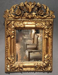 French Fine 17th c. Mirror , Aix en Provence Louis XIV Period  Rare Linden wood mirror finely carved and gilded. Rectangular model decorated with openwork acanthus spandrels in the corners and reserves to smooth cartridges, sticks to Bérain in and laurel wreaths outside. The pediment pierced acanthus and two sunflowers.  Parquetry and beveled glass mercury original rare state of preservation (never dismantled)  Working Aix en Provence Louis XIV period to 1690-1700.