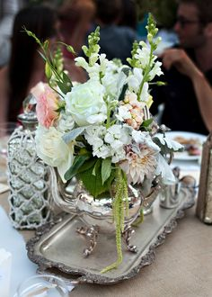 silver tray & silver teapot--I found a similar set at the goodwill that I will use for my wedding with different flowers....