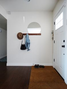 A Modern Ranch House Filled With Serendipitous Finds in Phoenix | Design*Sponge - round mirror tucked behind wall rack