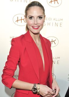 The Statement Lipstick-Suit Combo is Your New Summer Party Look: Heidi Klum went for a perfect match on her lips and suit, simply slicking back her hair into a ponytail and brushing a little extra color on her cheeks to keep from looking washed out.  | allure.com