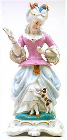 """An lovely antique porcelain Veilleuse-Theieres, or 'night-light' teapot. Items like this one were used in 18th through mid-19th c. to hold a candle - they acted as both nightlight & tea warmer. This elegant """"Lady of the Court"""" holds a fan (the spout) - her powdered wig, gown & little dog would suit Marie!  It is in the Trenton Teapot Collection - world's largest collection of Veilleuses-Theieres."""