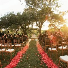 Fresh flower petals along each side of your aisle