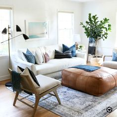 Love the big pouf as a coffee table