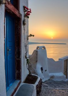 A paved trail leading to the sunset in Santorini island, Greece - Selected by www.oiamansion.com