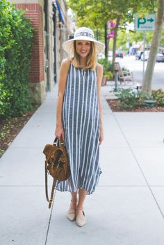 Image Via Little Blonde Book in the Sleeveless Buttondown Tunic #Anthropologie