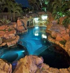 Kind of how I want my pool to look.. natural, but I want a swim up bar or in water table in it too.