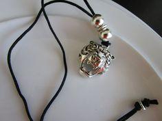 Silver tone tiger pendant on black cord tiger by LeeliaDesigns