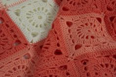 """""""Gerbera"""" is a handmade baby blanket. The ultra soft, light-weight and warm acrylic yarn in vivid peach colours invokes images of the beautiful autumn gerbera. Let your baby feel its soft embrace."""