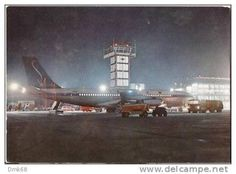 Milan Malpensa Airport at night with a SABENA B-707 on the tarmac...