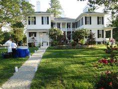 Back of the house at Symphony Gala showing new patio area and renovated rear porch-charming exterior room effect!  go to www.rsol.org for tickets and events