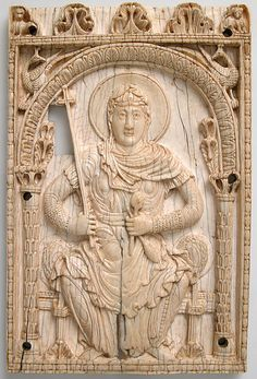 Ivory Carolingian plaque from Aachen, Germany, with the Virgin Mary as a personification of the Church, c.800-25; her military appearance and cross-topped sceptre symbolise triumph, and her spindle is a symbolic reference to the Annunciation. (Metropolitan Museum of Art)