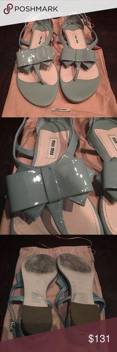 Miu Miu light teal blue patent now sandals Miu Miu light teal sandals. Patent leather. Bow detail at front. Silver clasp with various holes to adjust. About a 3/4 inch heel Miu Miu Shoes Sandals