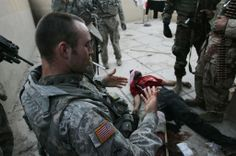 U.S. Army Sgt. Sergej Mithaud, of El Paso, Texas, from 1st Cavalry Division, Charlie company 2-12, smokes after treating a suspected Iraqi Shia insurgent they had shot earlier and tracked by his blood trail February 8, 2007 in the Gazaliyah neighborhood of Baghdad, Iraq. Troops eventually followed the blood trail to a hiding suspected insurgent, allegedly with the Shia Mahdi Army. (Photo by Chris Hondros/Getty Images)