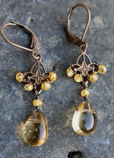 These earrings are made with honey quartz drops, czs and brass findings.  I wire wrapped the czs onto the brass filigree.