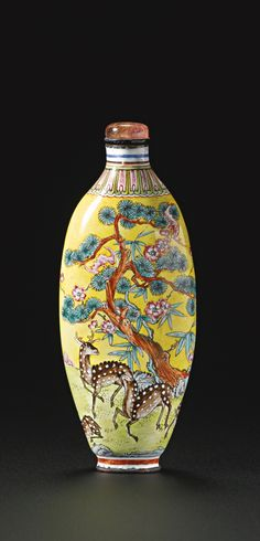 An Imperial Canton enamel 'Longevity and Good Fortune' snuff bottle, Qianlong mark and period (1735-1795 AD).
