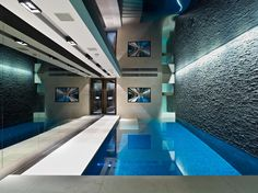 Indoor pool in Rutland Gardens House London by Originate Architects _