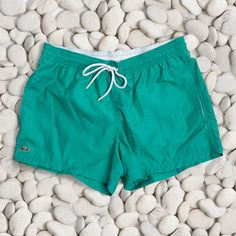 Dive in with style this summer in these green swim trunks.