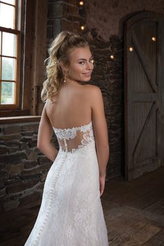 Sweetheart Gown 1121 - The perfect amount of playful details are in this slim A-line gown with sweetheart neckline. The allover Chantilly gown is lightly beaded and the stunning illusion back is lace-lined - The Blushing Bride boutique in Frisco, Texas