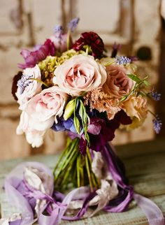 rich claret and apricot look lovely with plum and lavender accents.