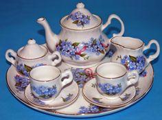 Miniature Porcelain Tea Set White w Pretty Blue Floral w Red Green, Tray, Teapot w Lid, Sugar w Lid, Creamer, Two Teacups w Two Saucers.