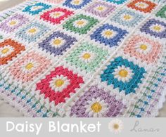 Daisy blanket - tutorial provided (such pretty colours!) A baby blanket in granny squares with a daisy in the center.     All daisies have white petals, and a yellow center.  The flower then is turned into a granny square.      Lanas de Ana
