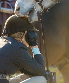 5684C1.jpg :: A tender moment during lull in action between teen girl and her horse at show jumping event.