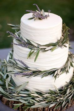 Wedding Cake adorned with Lavender and Olive Branches | SusieCakes (susiecakes.com) | Amy and Stuart Photography