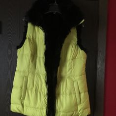 RELIST - Victoria Secret Faux Fur Vest w/mist PLEASE NOTE - This faux fur reversible jacket WAS brought on the Victoria Secret website some time ago however there are no original tags and markings that denote Victoria Secret.    Puffy part of vest is bright yellow and the reversible side is black faux fur.   Vest also includes a hidden hood which is fixed on to the collar see pic #3.  Size medium, never worn just stored on my closet.   No stains or rips.   Also included is the Victoria…