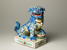 Figure of a shishi, or lion dog Arita kiln-sites  Europe 17th century	 possibly Kakiemon workshops (established mid-17th century) (potter) porcelain, probably mould-made, with hand-modelled details, and polychrome overglaze enamels Dimensions 20.3 x 18.3 x 10 cm max. (height x width x depth) width at base 20.3 x 15.2 x 10 cm max. (height x width x depth)