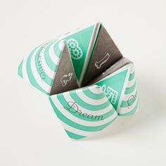 the fancy letterpress version of those fortune-tellers we made as kids.