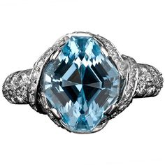 Tiffany & Co. Jean Schlumberger Aquamarine Ring. This extraordinary Tiffany & Co. aquamarine ring is the epitome of glamour. Designed by the legendary Jean Schlumberger, this striking design centers around a beautiful 4.97-carat, lozenge-cut aquamarine which displays an exquisite, ocean-blue hue. Diamond weighing 1.80 carats adds fire, while the intricate platinum setting adds drama. c 1970