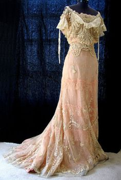 Victorian Tambour Lace early 1900's, fashion. ecru net, intricately embroidered. neckline and sleeves are trimmed with cotton ruffles, ribbon and lace trims.  The gown closes with hooks and eyes down the back.
